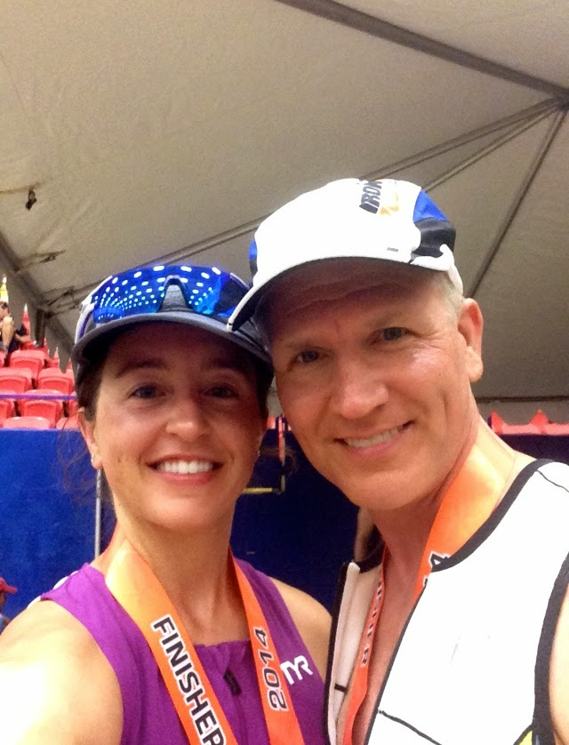 Ashley finishing her first half at IM 70.3 Austin with her husband.